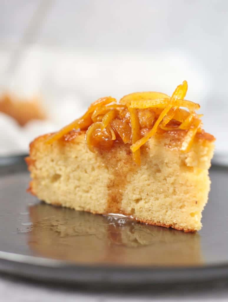 Slice of Orange Almond Cake with Orange Syrup and Marmalade